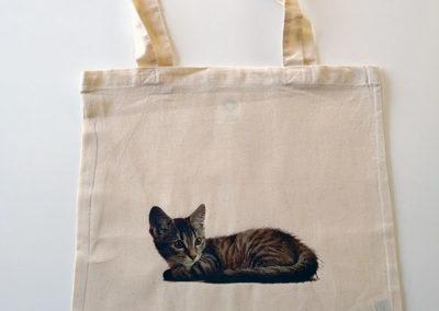 Un sac avec une photo d'un chat en transfert imprimé